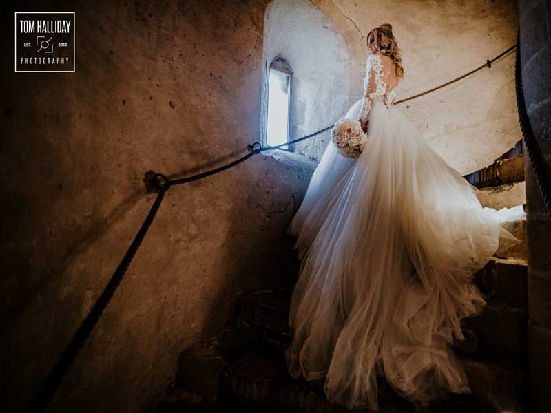 A stunning venue and dress makes for a beautiful composition