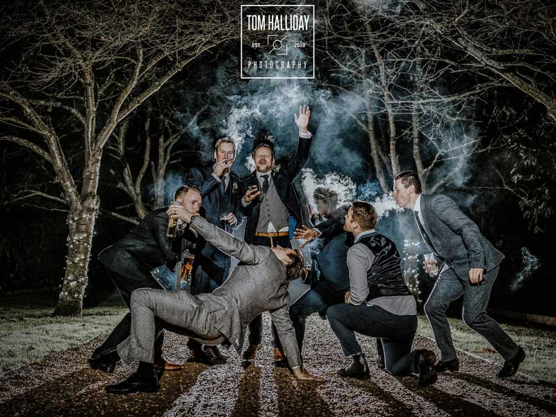 The groomsmen often like to have some fun in front of the camera.