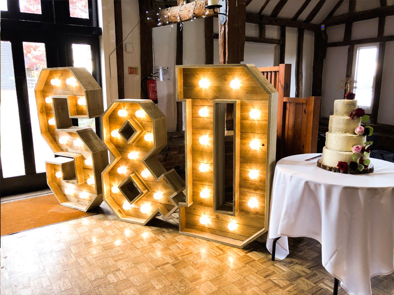 The couple had their names up in lights, complemented by a delicious cake.